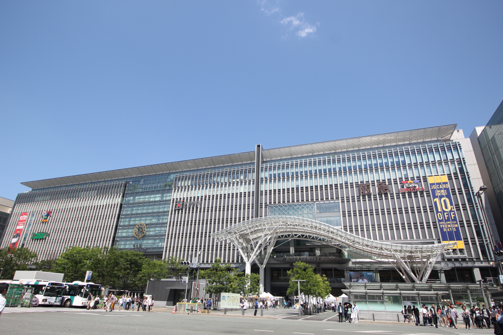 Hakata, Japan - May 26, 2018: Big and modern Hakata Station against beautiful blue sky. Hakata Station is a major railway station in Fukuoka. It is the largest and busiest station in Kyushu.