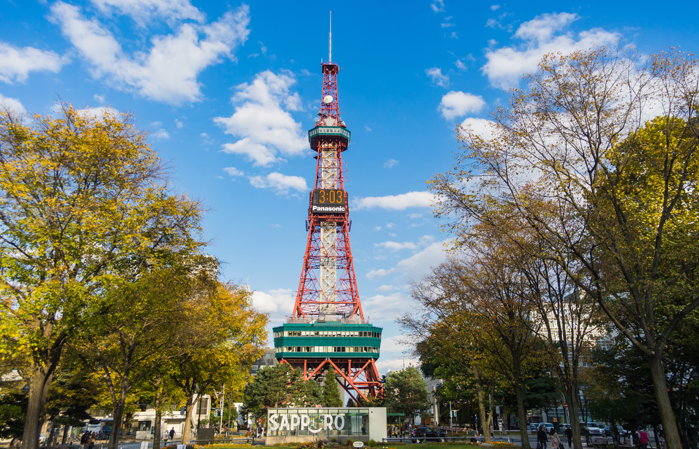 Sapporo, Japan : October 17, 2017 - The Sapporo TV Tower in Odori Park. Blue sky day in an autumn season with unknown tourists around the park.